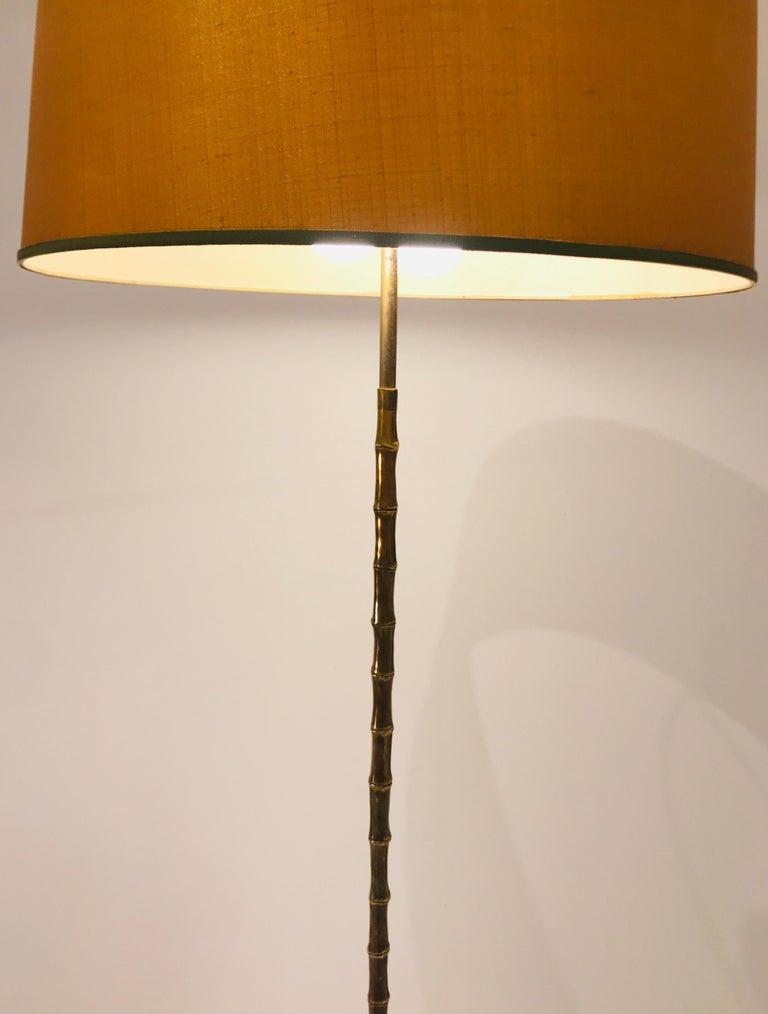 Floor lamp by Maison Baguès, faux bambou, bronze, circa 1950. New rewired. Dimensions : 50cm x 168cm H Without shade 37cm x 168cm H.