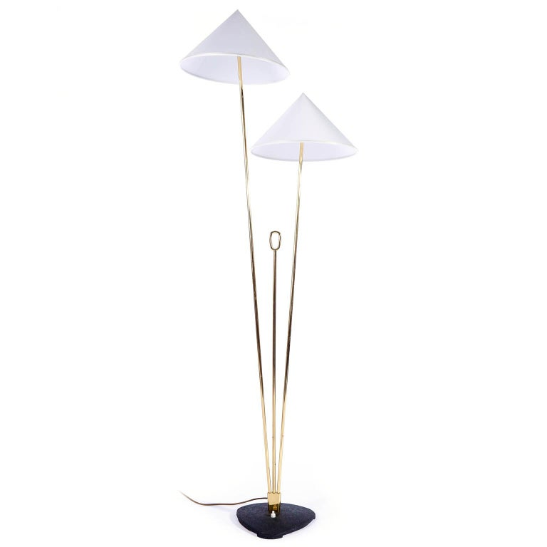 A brass floor lamp with cone shaped lampshades by Rupert Nikoll, Vienna, Austria, manufactured in midcentury, circa 1960 (late 1950s or early 1960s). The stand is made of two brass rods in different lengths and in between is a shorter brass rod