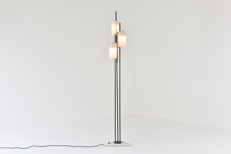 Floor lamp by Stilnovo, Italy, circa 1948. This midcentury floor lamp features a triangular marble foot, black lacquered steel and three opaline glass shades. Lovely brass suspension. All in very good original condition, newly rewired.