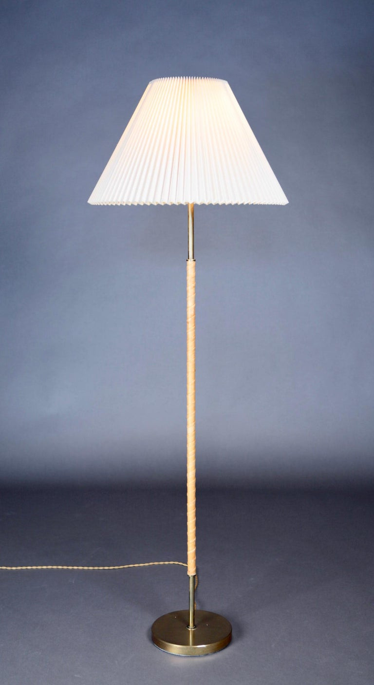 Leather and brass floor lamp by Harald Elof Notini for Böhlmarks, Sweden, 1940s.
