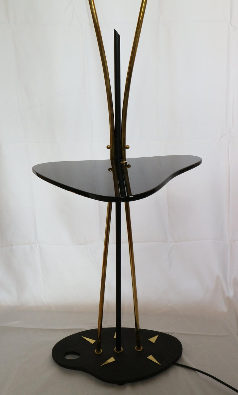 Decorative 1950's circa two head french brass floor lamp with a black glass detail.  We remain at your complete disposal for any other needs.  Lustri - Italy