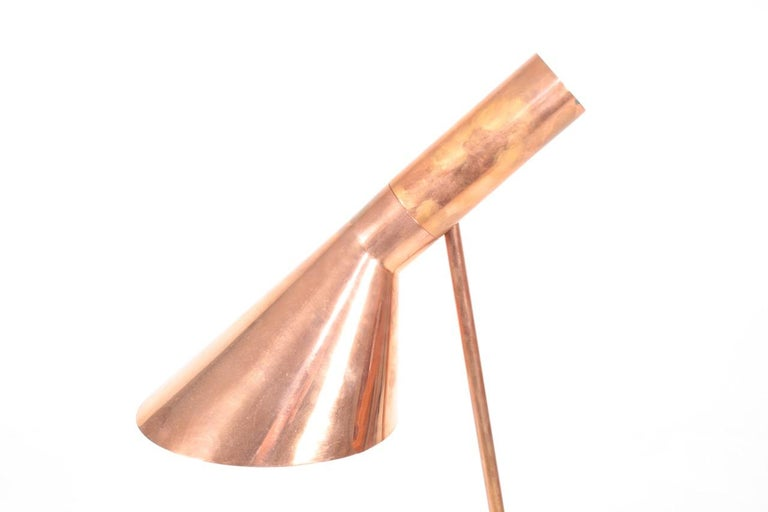 Rare floor lamp in copper. Designed by Maa. Arne Jacobsen for the SAS Royal Hotel in 1958 and made by Louis Poulsen Denmark, great condition.