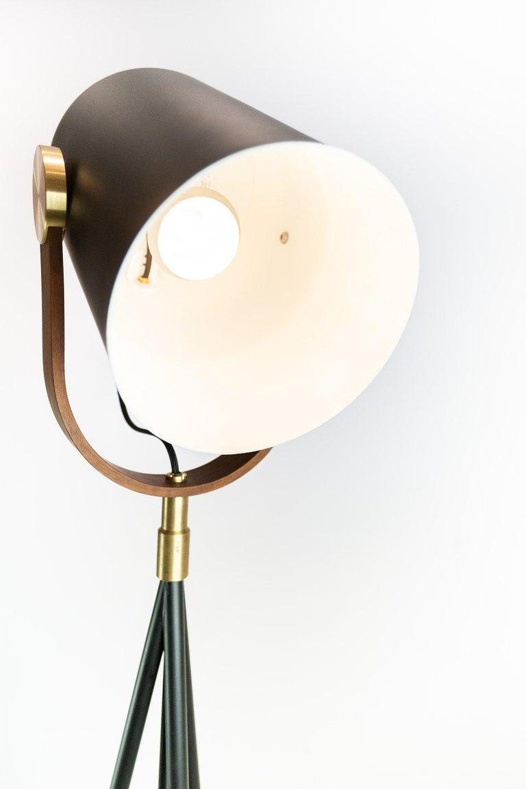 Floor lamp, model Carronade, by Le Klint. The lamp is of black metal and teak.