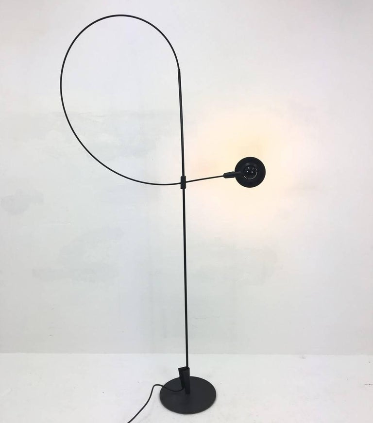 This floor lamp was designed by Rene Kemna for Sirrah in Italy in the 1980s. The structure allow the light and shade to articulate into various positions (head of lamp swivels 360 degrees).The tension of the form of this desk lamp is beautiful.