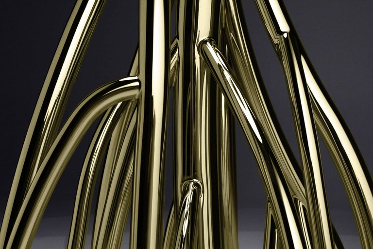 """The structure, the """"roots"""", of the floor lamp Mangrovia 'Em Flor' are made of mirror polished stainless steel, colored golden via a particular procedure. The floor lamp is composed of tubes of various diameters, the lampshade is made of golden"""