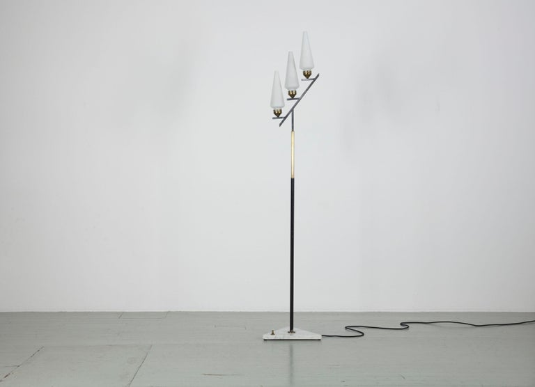 Floor lamp - Italy, 1950s. The lamp has three opal glass tubes, a lacquered metal rod with brass elements and a triangular marble base. It has been completely rewired.