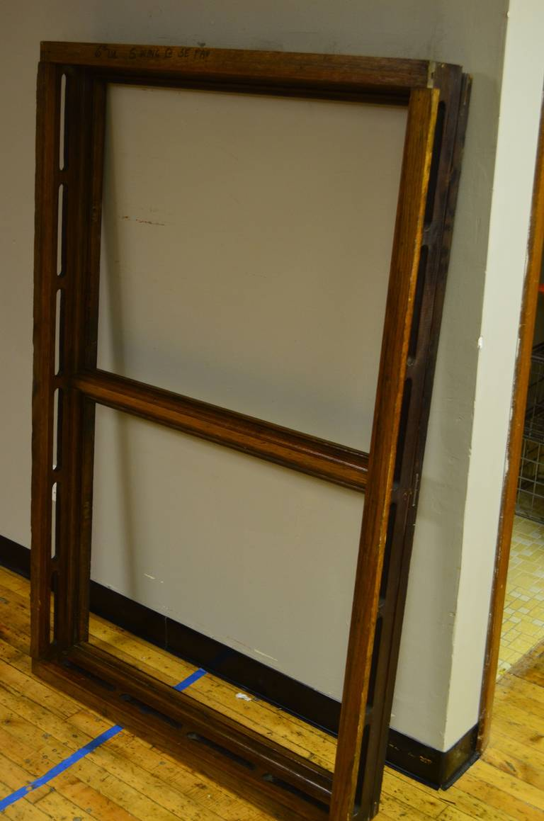 Floor mirror securely and firmly inserted into an antique oak skylight frame from the Wisconsin State Capitol. This skylight frame was built by hand and originally installed between 1906 and 1917 when the State Capitol was rebuilt after the