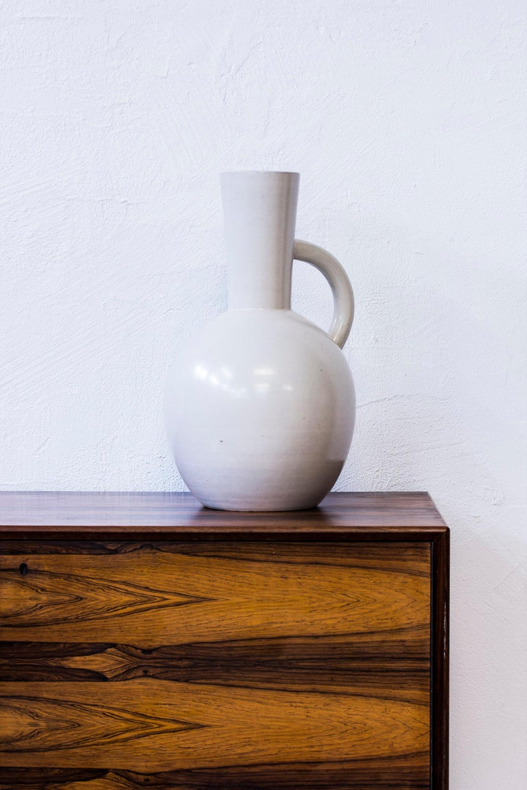 Floor vase designed by John Andersson. Handmade at Höganäs in Sweden. Made from earthenware with white semi glossy glaze. Very good condition with few signs of wear and patina.