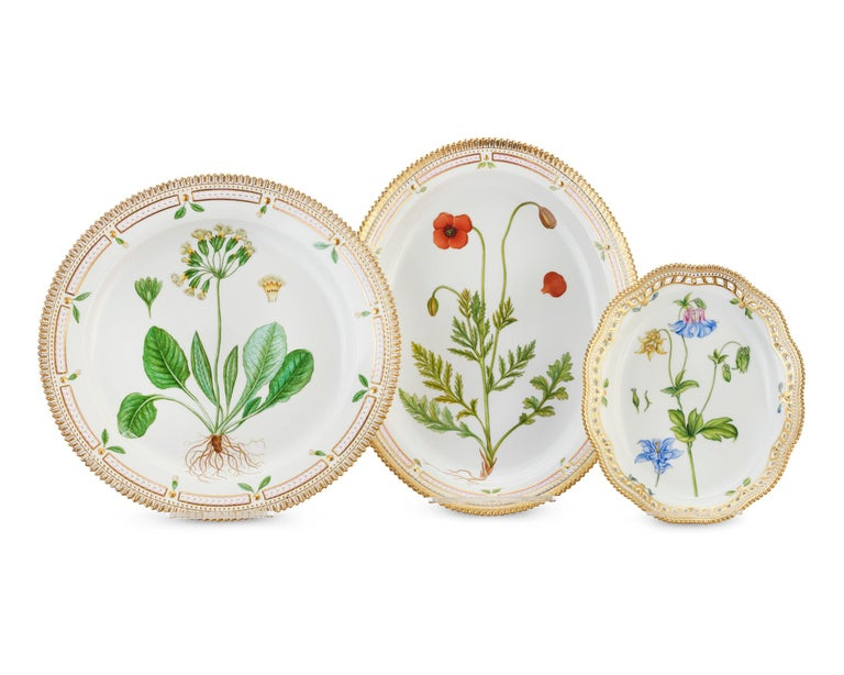 Crafted by the Royal Copenhagen Porcelain Manufactory, this 141-piece dinner service features one of the most prestigious porcelain patterns ever produced — the coveted Flora Danica pattern. The service for 12 boasts rich, hand painted botanical