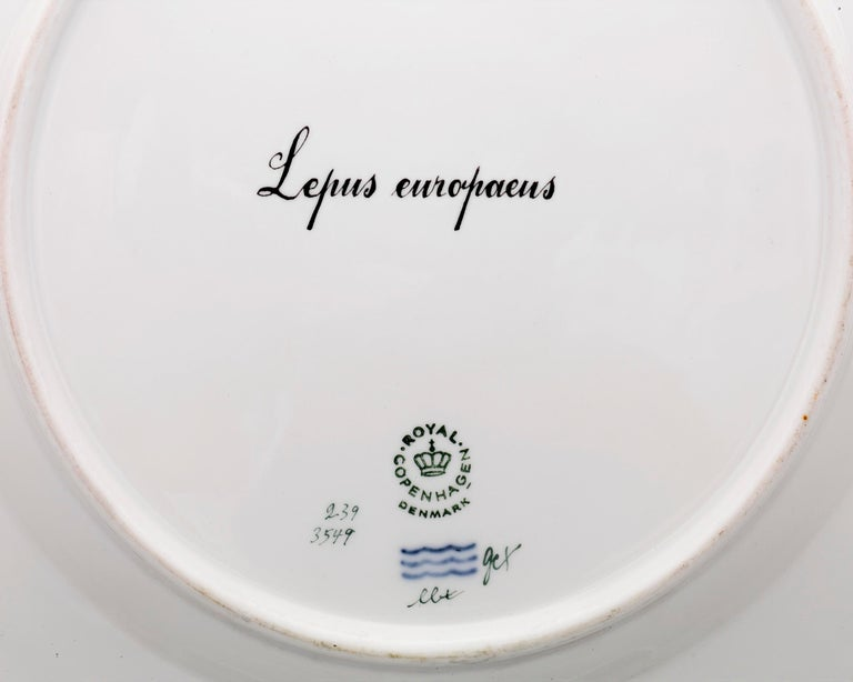 This charming porcelain dinner plate from Royal Copenhagen exhibits that firm's iconic Flora Danica pattern. While most Flora Danica dishes feature one of the native flowers of Denmark, this exceptionally rare plate boasts a Lepus europaeus, or