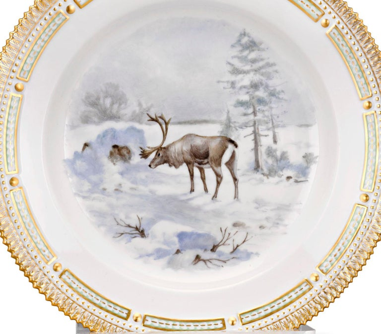 A reindeer is the star of the snowy scene on this extraordinarily rare porcelain dinner plate. Crafted by Royal Copenhagen, it is part of the firm's highly celebrated Flora Danica collection. Flora Danica is known worldwide for its intricate and