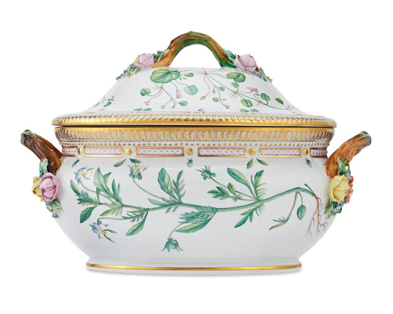 This quintessential Flora Danica soup tureen features a motif of rich, hand painted botanical illustrations taken directly from the collection's namesake Danish atlas of botany. Royal Copenhagen porcelain is crafted with meticulous skill and