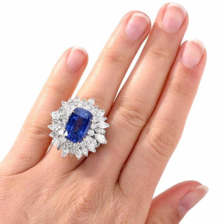 This exquisite sapphire and diamond ring is handcrafted in solid platinum, with an 18-karat yellow gold setting. Showcasing one rare genuine cushion-cut natural GIA lab reported Burma blue sapphire, with no heat, weighing approximately 13.65 carats