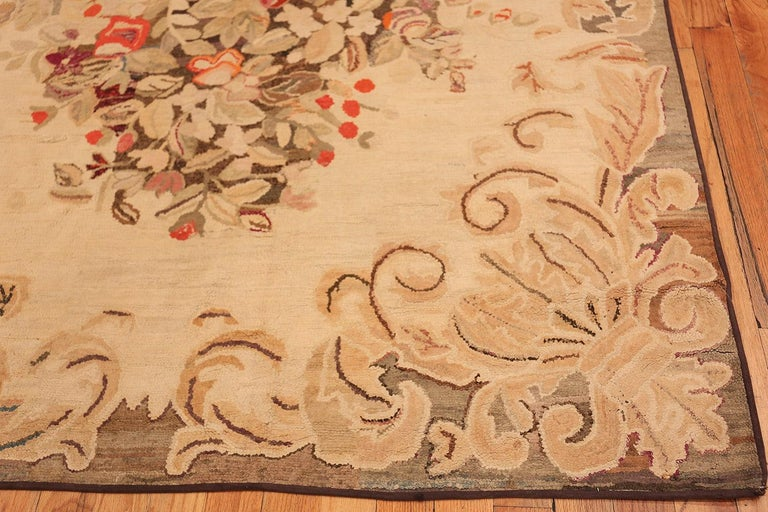 Beautiful floral antique American hooked rug, country of origin: America, date: circa 1900.