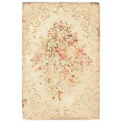 Floral Antique American Hooked Rug. Size: 6 ft x 9 ft 2 in (1.83 m x 2.79 m)