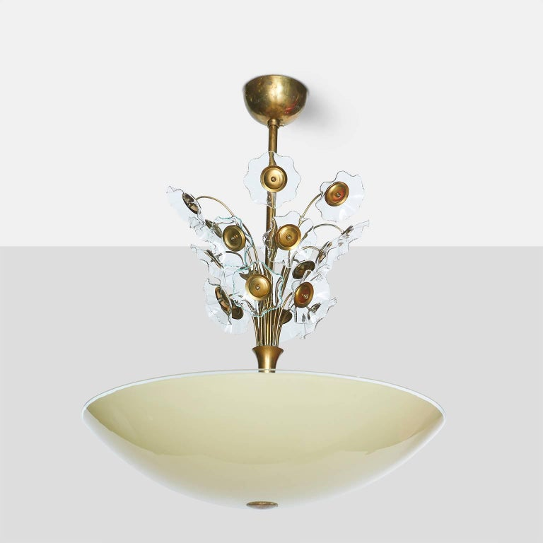 Floral chandelier by Lisa Johansson-Pape Large chandelier with a yellow glass shade and transparent glass flowers above the stem on an all brass frame, Finland, circa 1960s.
