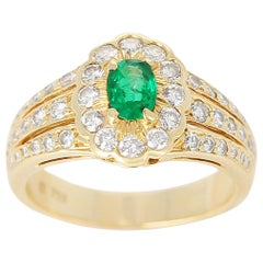 Floral Cluster Emerald and Diamond Ring, 18 Karat Yellow Gold