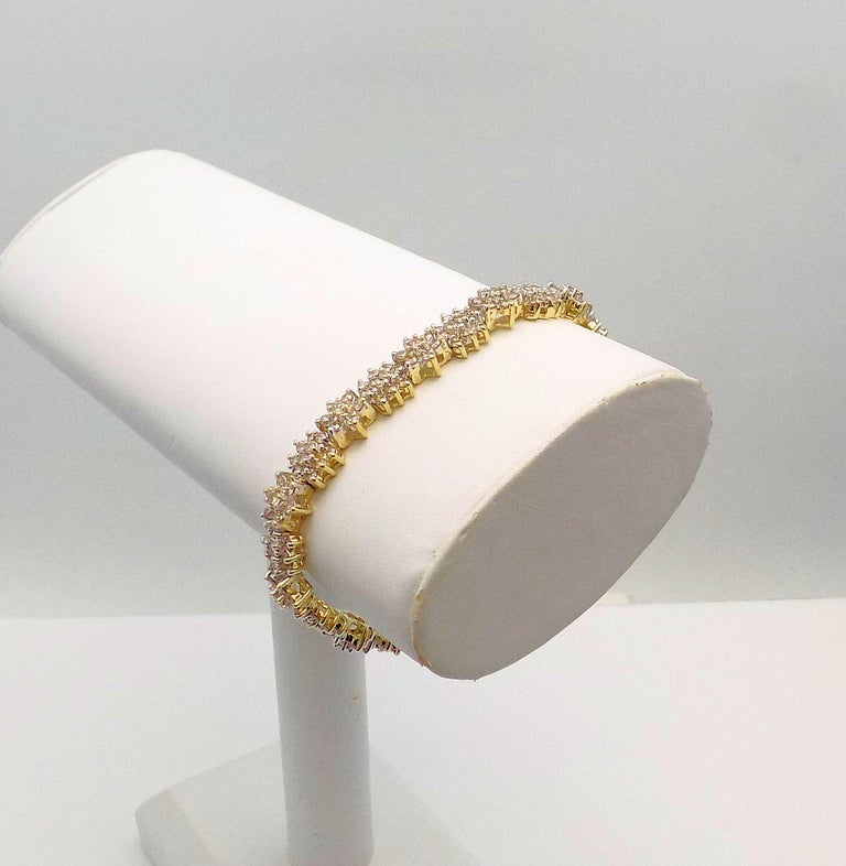 14 Karat Yellow Gold Line Bracelet Alternating Floral Design featuring 204 Round Brilliant Diamonds 3.20 Carat Total Weight, SI, Top Light Brown; 7