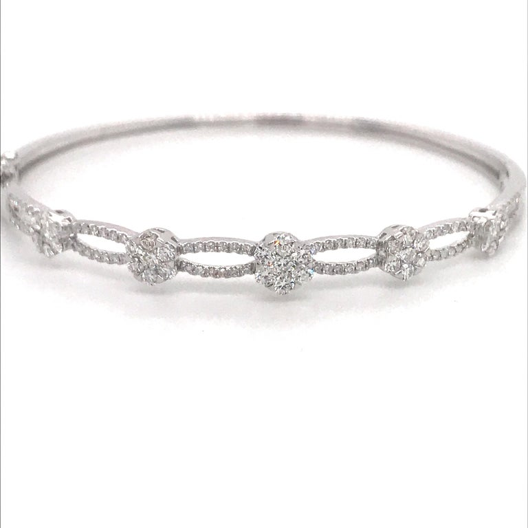 18K White gold bangle featuring graduated diamond floral & swirl design weighing 1.24 carats. Color G-H Clarity SI