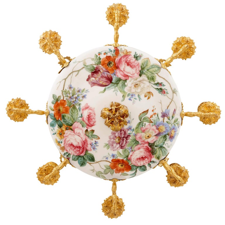 Beautiful flowers are the recurring motifs in the decoration of this wonderful antique chandelier, dating from the years, circa 1840. The most impressive features of the piece are the intricately-painted floral bouquets which adorn the opaline glass