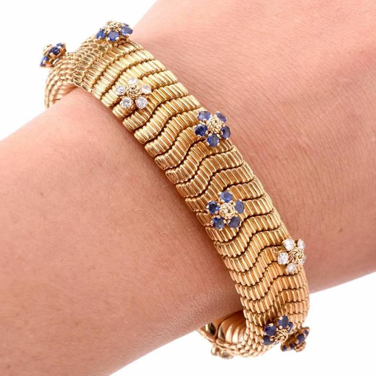 This conspicuous Retro bracelet of immaculate design and craftsmanship is constructed in solid 18K yellow gold, artfully textured on both sides to simulate the anatomically accurate pattern of snake scales. The double-faceted, skin-friendly bracelet