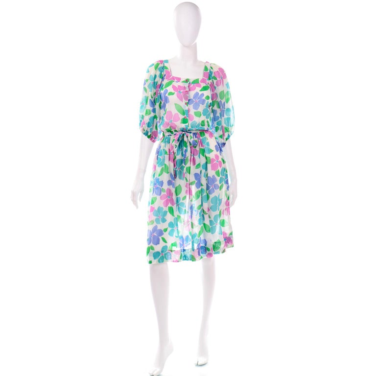 This is a fabulous vintage Albert Nipon Boutique light blue and green floral 3/4 sleeve length dress with waist belt. We love that this dress is so blousy and the sleeves are so voluminous ! Pearl Nipon, Albert's wife, was the designer for the