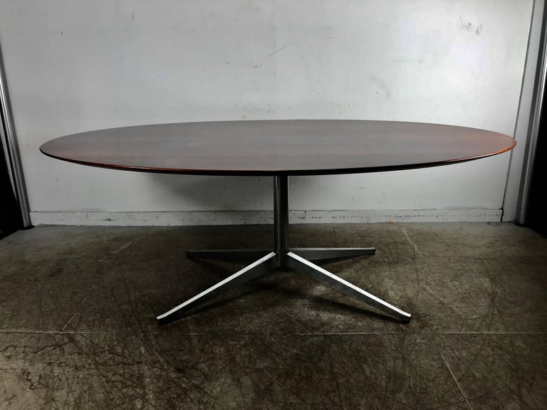 Florence Knoll conference or dining table, rosewood top for Knoll. Stunning example of a Classic Mid-Century Modern design, richly grained bookmatched rosewood.