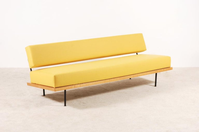 Very rare daybed designed by Florence Knoll and edited by Knoll International, circa 1950. Birch wood frame, feet and back in black lacquered tubular steel.  This daybed sofa have been fully restored and newly upholstered with a high quality wool