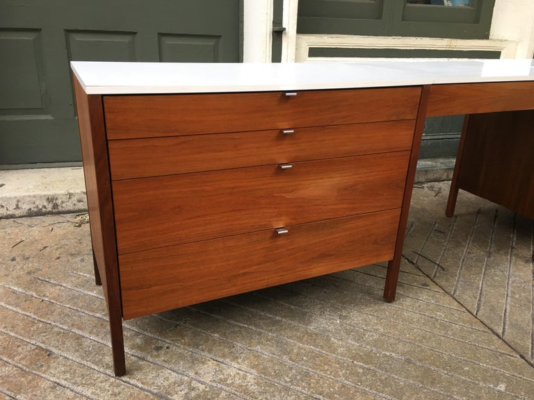 Florence Knoll for Knoll dresser and desk/vanity in walnut with white Formica tops and chrome drawer pulls. One three drawer and the other four with one drawer in suspended vanity/desk. All original and bought from the original owner.