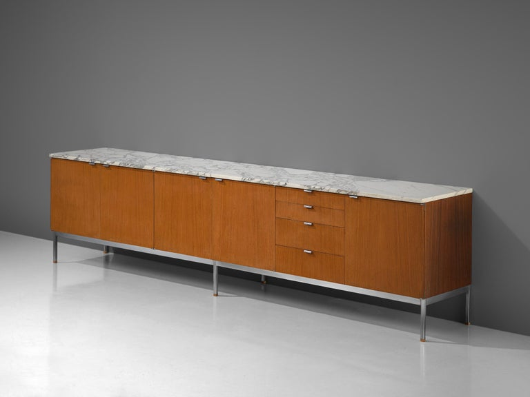 Florence Knoll for Knoll International, sideboard, teak, marble and metal, United States, 1961.   Iconic credenza with chromed base and marble top designed by Florence Knoll for Knoll International. It is rare to find sideboard with the length of