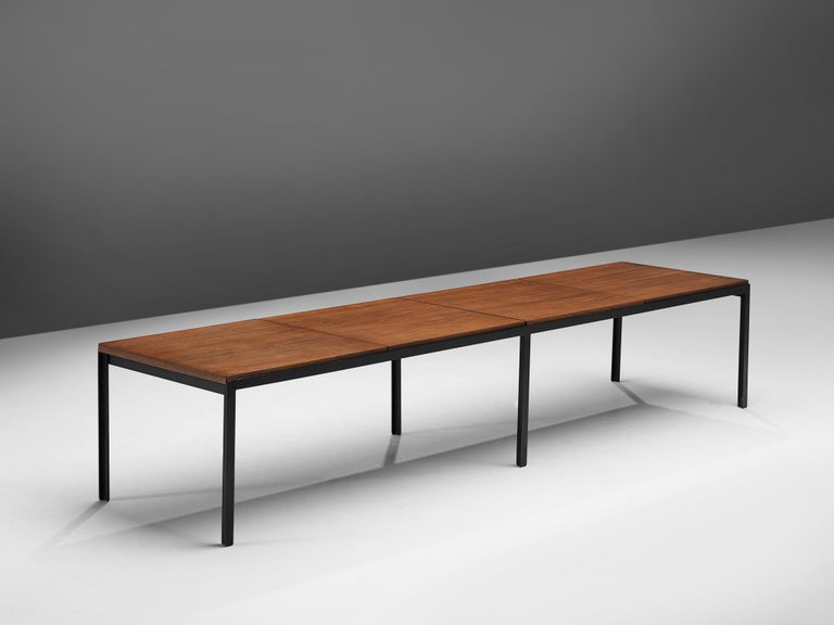 Florence Knoll for Knoll, T-angle bench, teak and metal, United States, 1950s  Large early production Florence Knoll angle iron and teak table or bench with segmented walnut top from the 'T-Angle' series. This is a very substantial piece and would