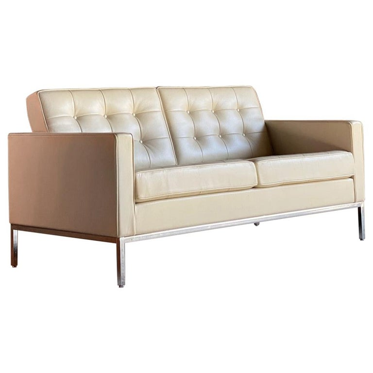Florence Knoll leather sofa by Knoll Studio  Sublime quality Florence Knoll for Knoll Studio model 1205S2C leather two-seat sofa, the chrome frame supporting the finest cream Spinneybeck HT513 leather button upholstered seats, this is an