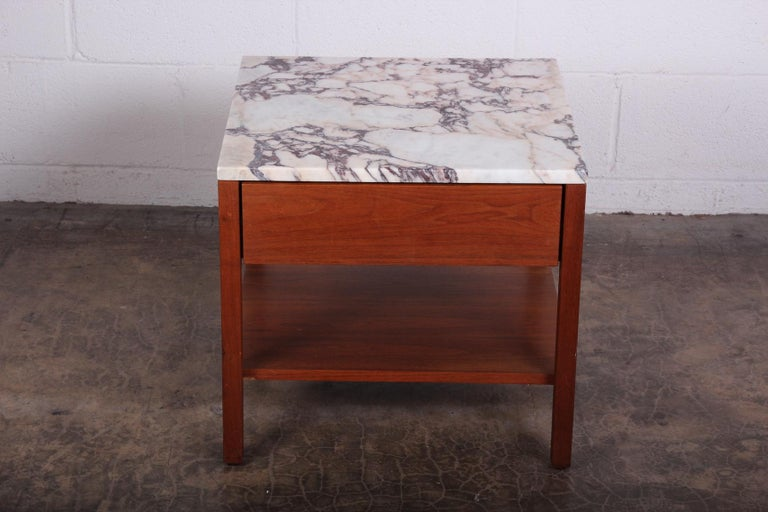 An early walnut bedside table with stone top. Designed by Florence Knoll for Knoll.