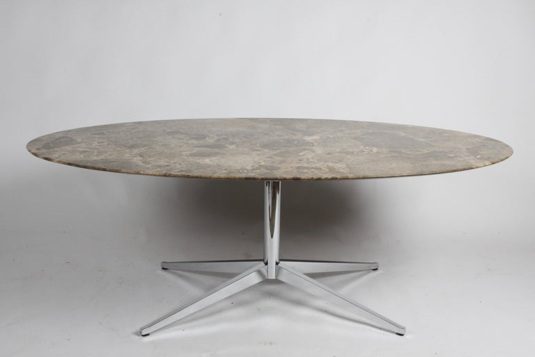 Classic Florence Knoll for Knoll dining table with oval Emperador marble top and chrome base. Emperador marble top colors are olive-beige tones, the marble is quarried in Spain. Chrome base legs have been newly polished and re-chromed. Table had a