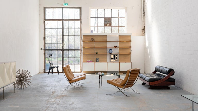 Rare wall shelf unit by Florence Knoll. Made by Knoll International, Stuttgart in 1952.  Cabinets and shelves are made of teak. The interiors are veneered with maple. Cabinet fronts in white. The doors of the cabinet modules elegantly sink into