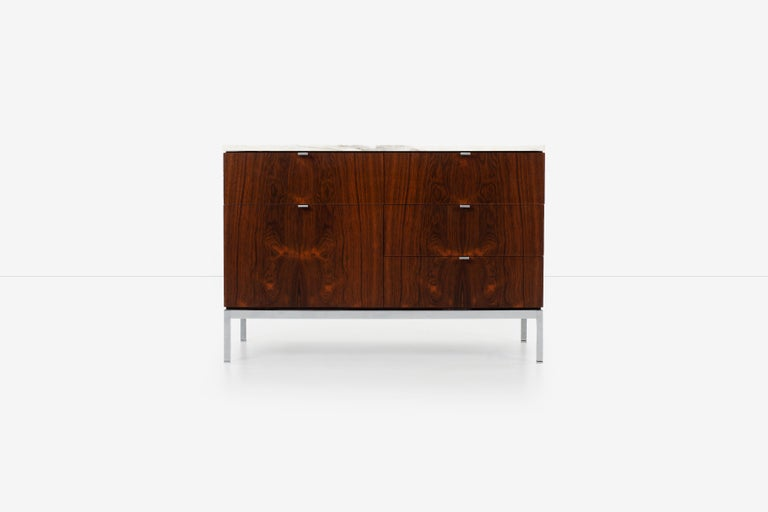 Florence Knoll rosewood credenza with marble top, Calcutta marble with book-matched highly figured dark rosewood veneer (1961), Cabinet appropriate for a dining room, living room or office space. Made in Italy. 5 drawers, 4 with removable partitions