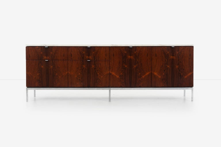 Florence Knoll rosewood storage cases, Calcutta marble tops, with book-matched highly figured dark rosewood veneer (1961), Cabinets appropriate for a dining room, living room or office space. Made in Italy. Larger case (right side) has two storage