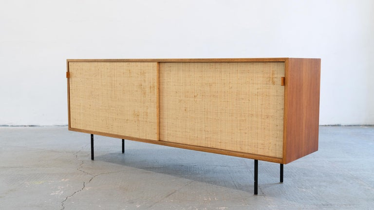 Sideboard (Mod°123) from 1968, designed by Florence Knoll for Knoll International - this version was produced in 1968 by Knoll International in Stuttgart.  The sliding doors are woven with Seagrass, a beautiful, warm and subtle detail.  Stitched