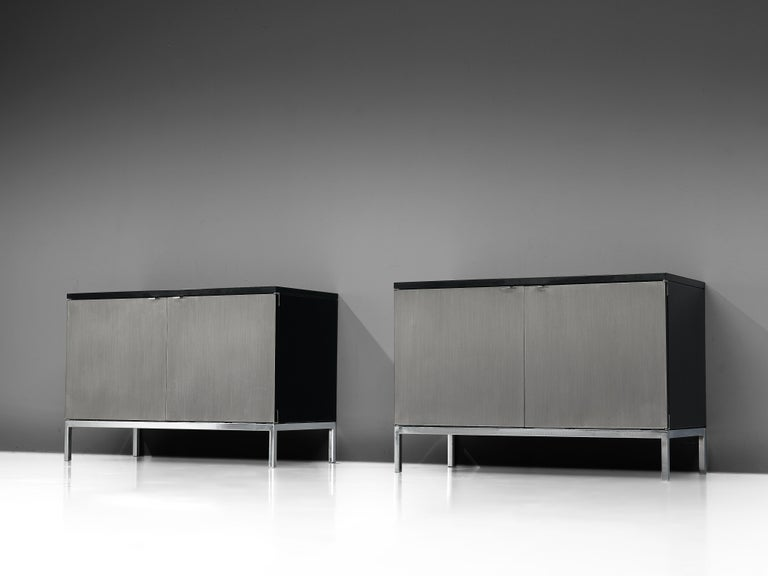 Florence Knoll for Knoll International, two sideboards, oak, brushed steel,United States, design 1960s  Two modest sized credenzas with a chrome base designed by Florence Knoll for Knoll International. These exceptional and minimalistic designed