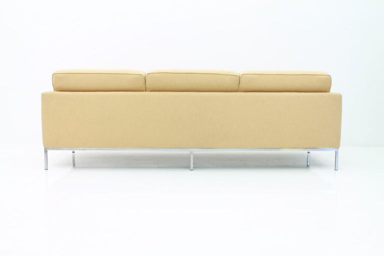 Three-seat sofa by Florence Knoll and made by Knoll International. The sofa was newly upholstery, circa three years ago.  The condition is very good.