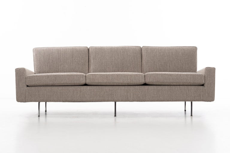 Model no. 26 three-seat sofa. Upholstered with new foam in Cato fabric. Chrome plated legs. Measures: SH 20.