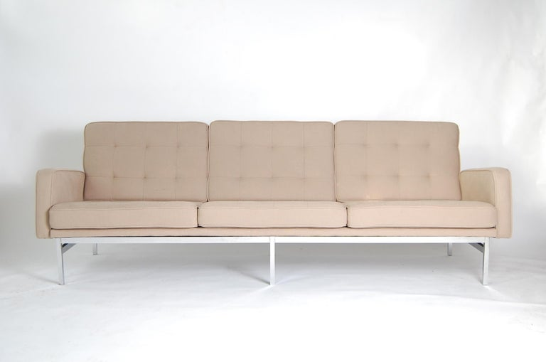 Sofa designed by Florence Knoll, and produced by Knoll Associates, circa 1966. Recently upholstered, including all new foam and strapping.  Please note: Unfortunately, this sofa was sent out on approval, and was returned to us with minor stains.