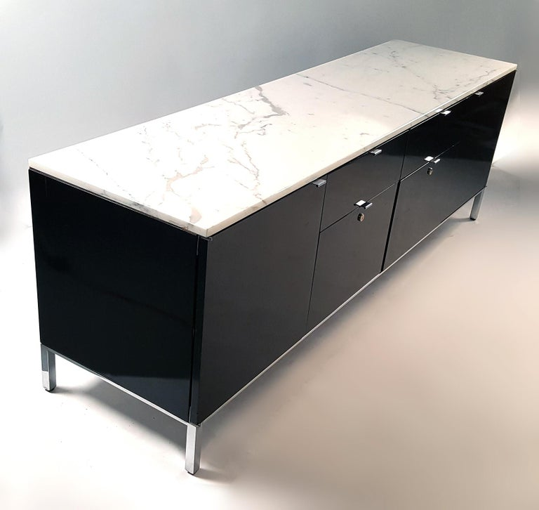 Beautiful credenza with matching file cabinet designed by Giacomo Buzzittan for Stow Davis. The matching set has Carrara marble tops, black lacquer cabinets with chromed steel bases and drawer pulls and will work great in any modern environment. The