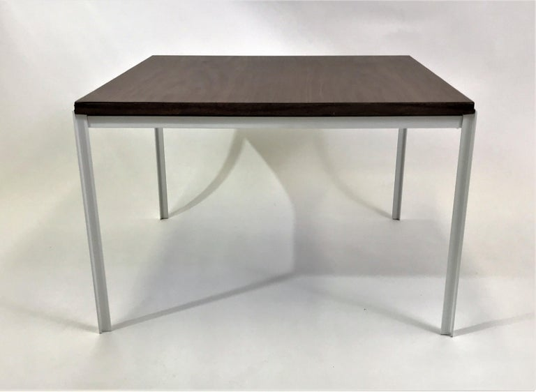 Designed by Florence Knoll in the 1950s, this T angle table with a walnut grain laminate top and white iron base. In very good condition, the base re-patinated and the laminate top in very good vintage condition showing little signs of use. For use