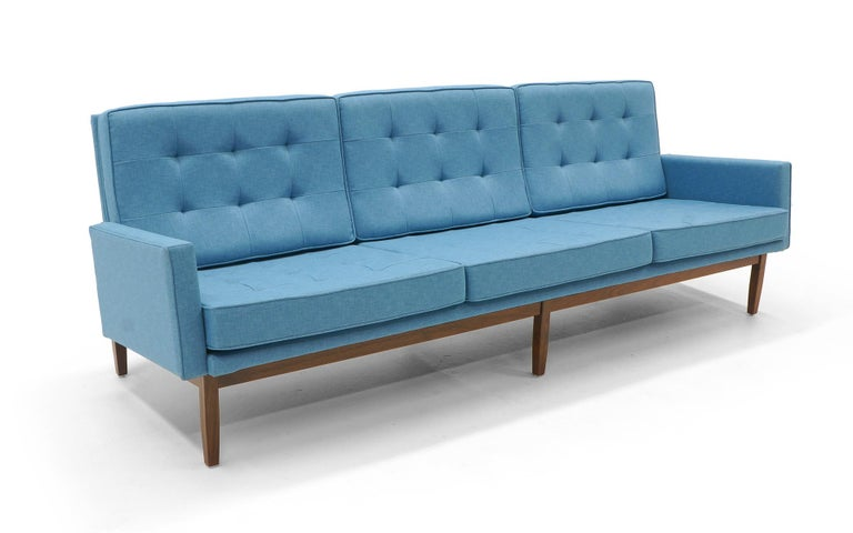 Classic florence Knoll tufted back sofa with the highly desirable walnut frame. Beautiful light blue color expertly restored and reupholstered. Excellent in every way.