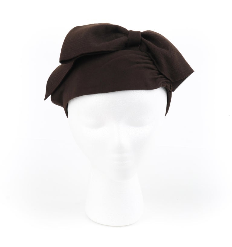 """FLORENCE MILLINERY COUTURE c.1940s Chocolate Brown Felt Front Bow Turban Hat   Circa: 1940's Label(s): """"Florence"""" Millinery, Glencoe Illinois Style: Turban hat Color(s): Chocolate brown (exterior, interior) Lined: No Unmarked Fabric Content: Felt"""