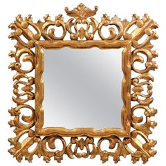 Florentine 20th Century Carved Giltwood Mirror with C-Scrolls and Foliage Motifs