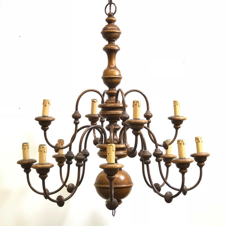 Illuminated by 12 lights, this Florentine Florence Renaissance style chandelier from Italy is made of colored metal and lacquered wood. For maximum effect it requires 12 European E14 Candelabra bulbs each up to 40 watts. Approximately 35 inches high