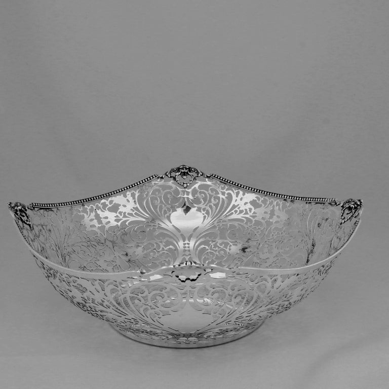 This fine Italian bowl is marked by a considerable silversmith, Ugo Bellini from Firenze. This type of cutwork is rarely made these days. It takes a long time and would therefore be very expensive. The base is round and the body of shaped square