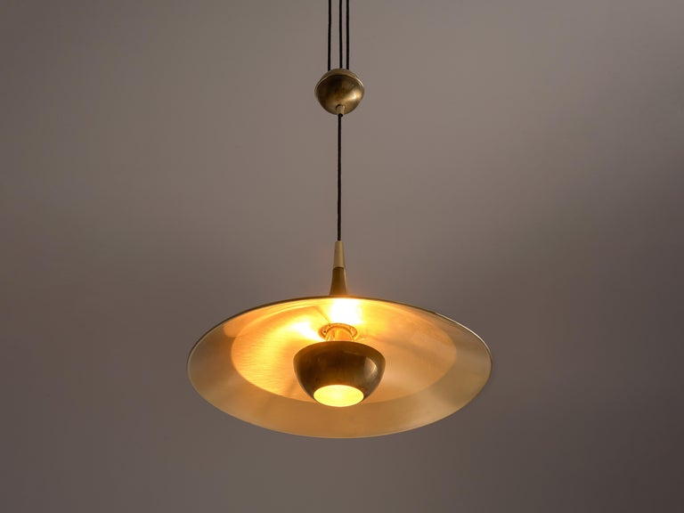 Florian Schultz, pendant, brass, Germany, 1960s  Very elegant shaped brass pendant from German production by Florian Schultz. This well made piece is equipped with a narrow infundibular shaped end which leads the wire by a trough the ceiling. Due